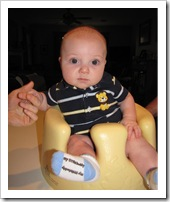 Serious guy in his bumbo chair, 7-26-09