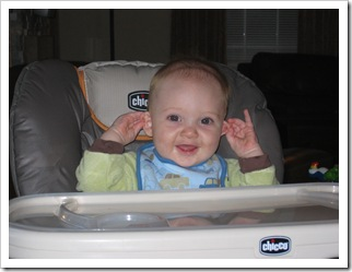 Aunt Holly:  Guess what he's doing?!  He's twiddling BOTH his ears! He might be your perfect baby after all!! :) 11-26-09