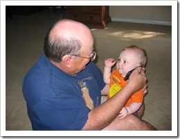 "Papa & Reid ""talking"" on the phone with us while we were gone, 11-15-09"