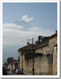 Typical Antigua street with a volcano in the background.
