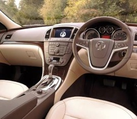 This is the interior - beige leather and light brown dash panels