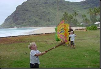 Jonas hitting pinata