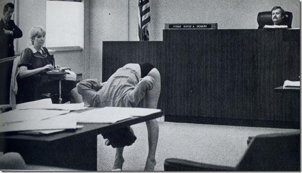 lady bending over in court room