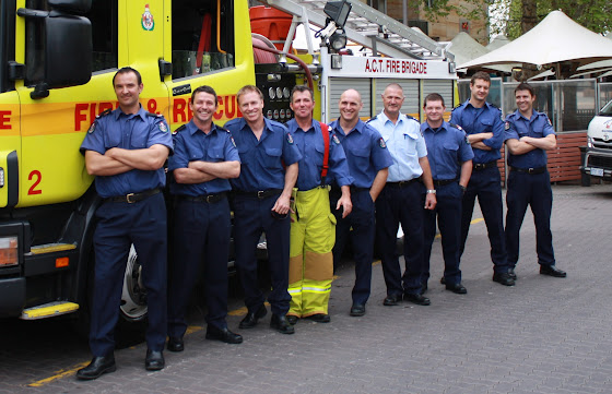 firefighters posing