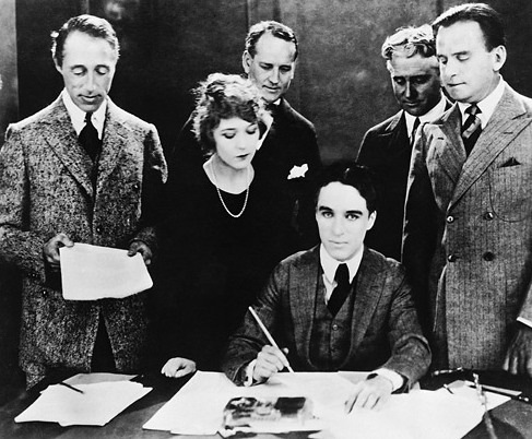 Chaplin signs the contract to establish United Artists