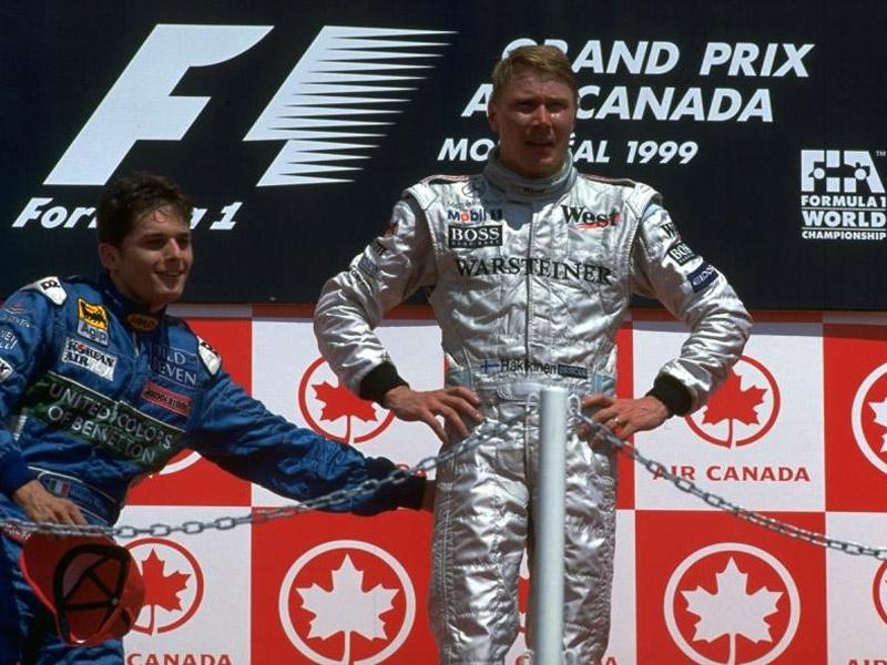 Джанкарло Физикелла и Мика Хаккинен на подиуме Гран-при Канады 1999