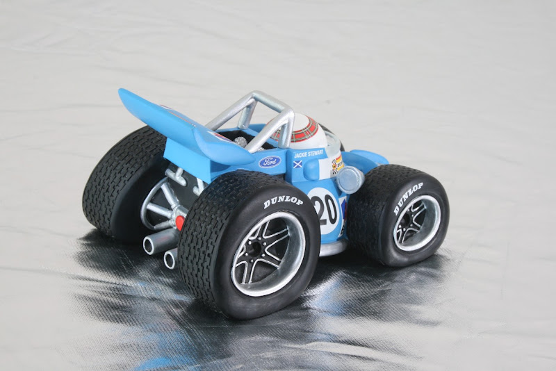 вид сзади игрушечного Tyrrell Джеки Стюарта в стиле комиксов Jim Bamber