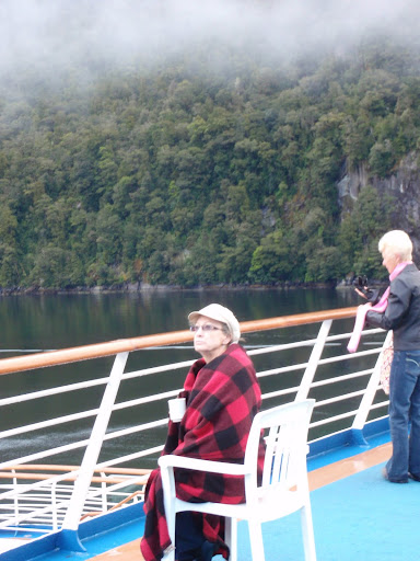 Coffee and a warm blanket made shipboard viewing the fjords more enjoyable From 12 Tips to Optimize your Cruise Experience