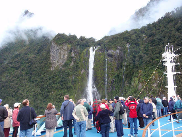 Passengers gather on deck for views of the waterfalls From 12 Tips to Optimize your Cruise Experience