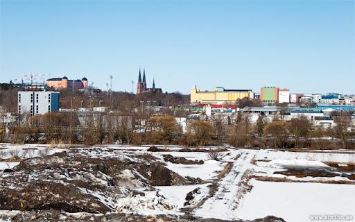 Vy norrut mot Uppsala från snöhögen på Kungsängen