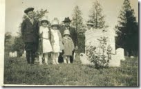 Grampie, Grammie behind the tombstone Joy, Laurel, Bessie, Valeda