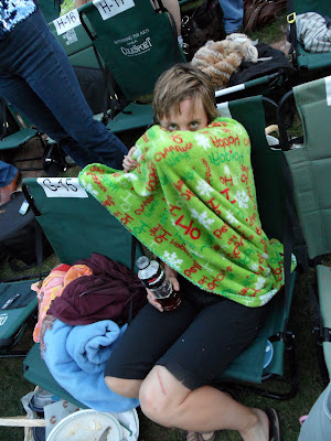 These are the blankets and general demeanor that we brought to the event. Everyone else in designer jeans and $1500 outfits and us in Santa blankets. This was one of the high points of our visit. Seriously.