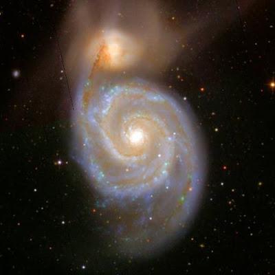 Resultado de imagen de Una Galaxia pequeña es absorbida por otra mayor