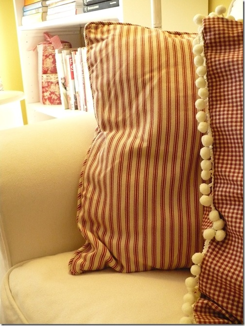 red ticking and toile pillows