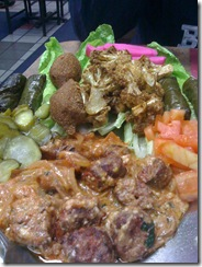 Meze platter: Stuffed grape leaves, lamb kibbe, karnabeet, sujok sausages
