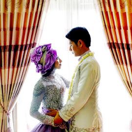 front of the window by Fora Ginanjar Katamsi - Wedding Bride & Groom ( kiss, hug, window, wedding, bride and groom, bride, groom )