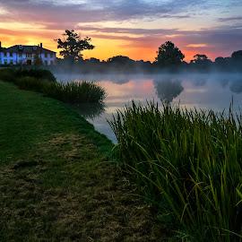 Sunrise on the Lake by Jack Hardin - Landscapes Sunsets & Sunrises ( water, lake, house, morning, landscape, manor, dawn, fog, vista, sunrise, atmospheric, misty, mist )