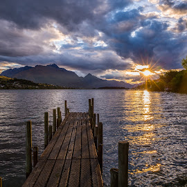 by Pete Whittaker - Landscapes Sunsets & Sunrises ( water, clouds, reflection, mountain, waterscape, lake, landscape, storm, new zealand, sun, photography, mountains, starbursts, sunset, summer, landscapes )