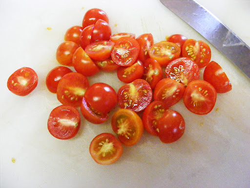 Cut a pint of cherry tomatoes in half.