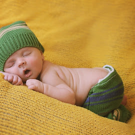 Baby on Yellow by Kitty Schaub - Babies & Children Babies ( green, yellow, sleeping, baby, boy, newborn )