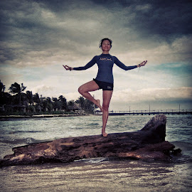 Balance Tree Pose during wind storm on island by Tammy Tran - Sports & Fitness Fitness ( yoga pose tree pose balance log water sea ocean island hurricane storm wind powerful yogini,  )