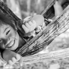 Super Girl by Justine Carlyle - Babies & Children Child Portraits ( child, girl, black and white, play, children, happiness, beauty, swing, hammock, smile, cambodia, siem reap,  )