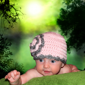 Reaching out by Dawn Vance - Babies & Children Child Portraits ( girl, green, trees, blue eyes, pink, baby, gray, portrait )