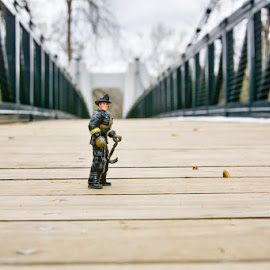 The long walk. by Craig Hicks - Artistic Objects Toys ( rebuild bridge, fireman, overcast, wooden slats )
