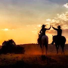 High Five by Kimber Wallwork-Heineman - Uncategorized All Uncategorized ( clouds, moods, horses, colorful, cowgirl, happiness, vibrant, congratulations, people, horseback, high five, comraderie, sunset, january, emotions, sunrise, evening, golden hour, mood factory )