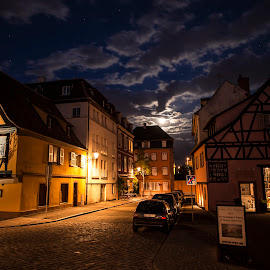 The Moon Shining Through  by Lillian Molstad Andresen - Buildings & Architecture Places of Worship ( moon light, clouds, doors, halph timbered houses, moon, houses, moods, april, colmar city, 2014, street, windows, alcase province, spring, city, sky, cars, nikon d800, stars, buildings, night, france, colmar,  )
