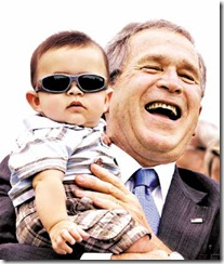 26story15_1 President Bush with a child