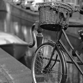 A ride along the canal by Carl Maskelyne - Transportation Bicycles ( cycle, pannier, barge, bike, wheel, basket, amsterdam, canal, bicycle )