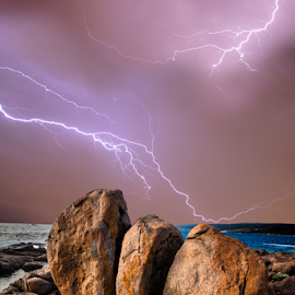 Thunder claps over head by Craig Eccles - News & Events Weather & Storms ( water, clouds, thunder, lightning strike, news, waves, lightning storm., sea, ocean, beach, storm, lightning, sky, lightning bolt, event, weather, thunder and lightning, thunder storm, thunder bolt, rocks )
