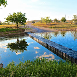 Boat landing reflections by Kathy Suttles - City,  Street & Park  City Parks