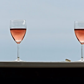 closing time and a glass of wine by Uschi Rules - Food & Drink Alcohol & Drinks ( wine, shell, red, sky, blue sky, blue, relaxed, wine glass, glass, relaxation, relaxing )