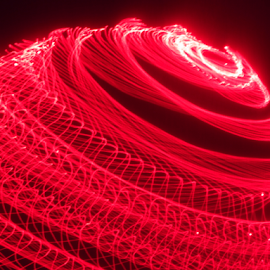 Swirling planet ! by Jim Barton - Abstract Patterns ( planet, laser light, red, light design, laser design, laser, space, light, science )