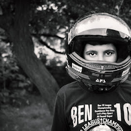 Schumacher in the making by Kunal Khurana - People Street & Candids ( expression, child, street, candid, helmet, portrait, kid, eyes )