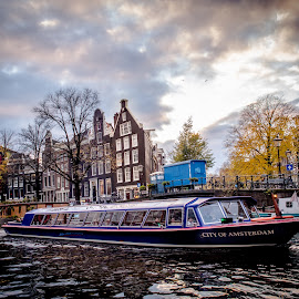 Canal Boat in Amsterdam by Joan Rankin Hayes - Transportation Boats ( water, canals, europe, pilgrimage trip, boats, amsterdam, travel, netherlands )
