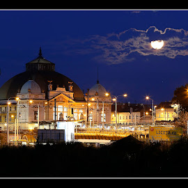 Train station in the background with the moon - Plzeň Czech Republic. by Martin Mourek - Buildings & Architecture Homes ( skyline, old, bus, america, street, travel, transportation, road, cityscape, architecture, north, usa, people, business, historic, city, sky, bike, japan, buildings, train, district, evening, light, downtown, clouds, financial, office, united, structure, building, station, clock, kyoto, national, tourism, scenic, japanese, urban, tower, railway, blue, outdoors, scene, night, town, scenery, outside )