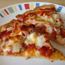 Ham, Cheese, and Tomato Pizza