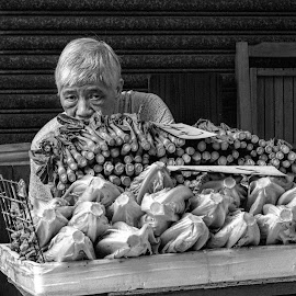 shy by Vibeke Friis - Black & White Street & Candid ( pxl, man hiding behind vegetables,  )