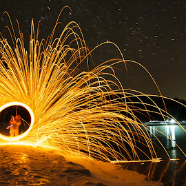 Spinning Wool at Splitrock Lighthouse by Mike Woodard - Abstract Fire & Fireworks ( cold, steel wool, night, fire, two harbors )