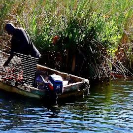 Fisherman on the Black River by Kim BraineOtt - People Portraits of Men ( fishing, fisher, boat, alone, portrait, man )