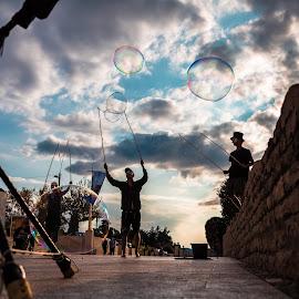 Bubble Makers by Stephen Bridger - City,  Street & Park  Street Scenes ( street buskers, street performers, bubble, europe, bubble makers, bubbles, croatia, travel, zadar, travel photography, street photography )