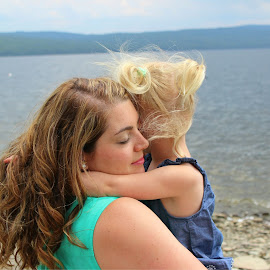 Mother & Daughter by Abigail Beard - People Family ( water, hug, daughter, parent, cousin, lake, photography, child, love, girl, curls, summer, hair )