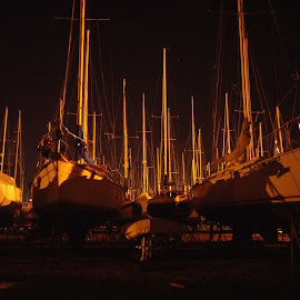 Dry Docked by Adam Skarzynski - Transportation Boats ( boats, night, sailboat, drydock, dock )
