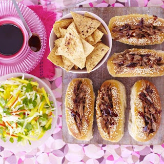 Sticky duck-dogs with chopped mango slaw & Chinese crisps