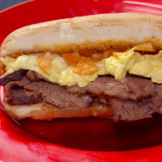 Beef Brisket Grinder with 3 Peppercorn Glaze, Steak Sauce Mayo, and Cheddar-Scrambled Eggs