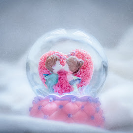 a kiss in the snow by Rakesh B.S - Artistic Objects Toys ( love, kiss, globes, snow globes, snow, snow globe )