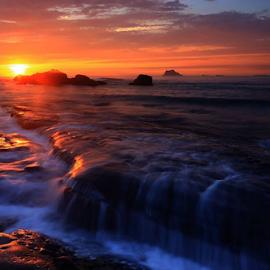 Sunset over the rocks by Angela Chen - Landscapes Sunsets & Sunrises ( water, sunset, rock, sunrise, rocks )